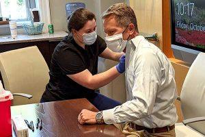 Chancellor Guskiewicz getting his flu shot